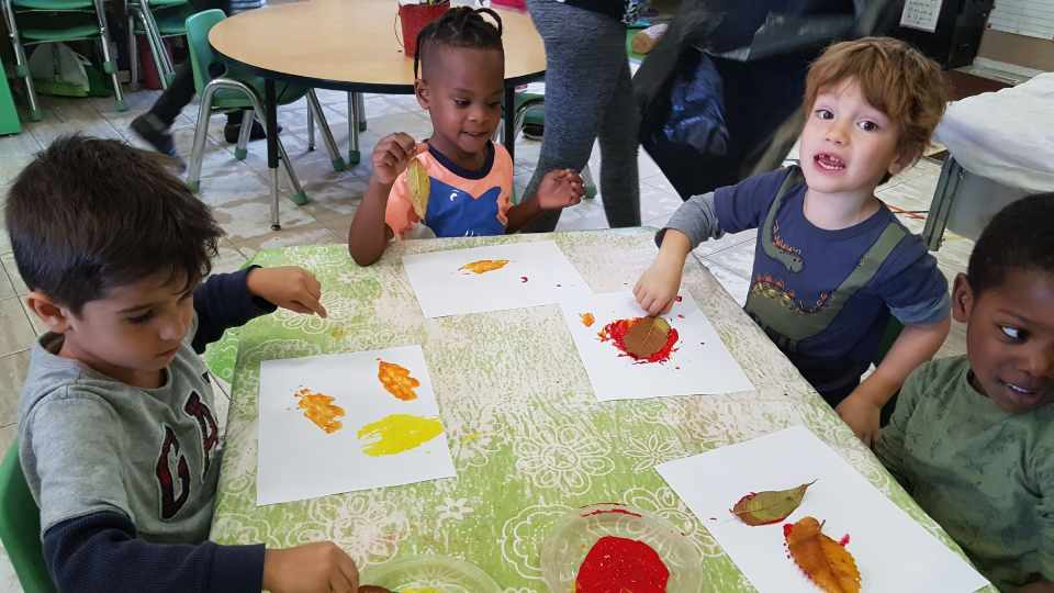children having fun with colors at day care