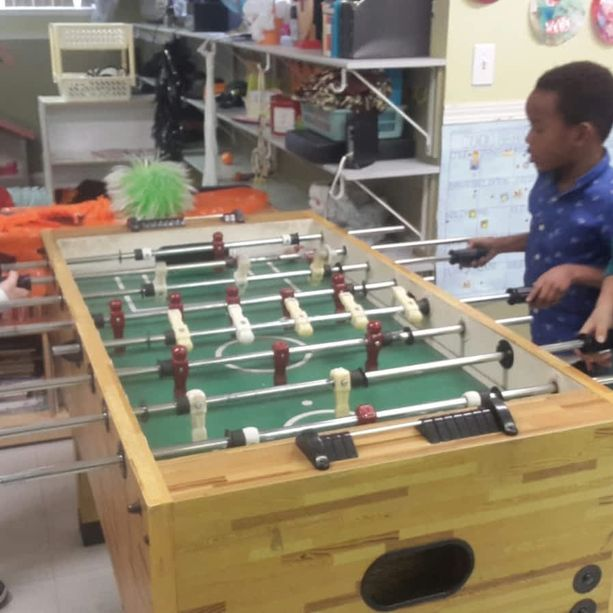 Children playing table football